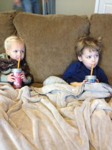 my little cuties drinking their smoothies. Yes, they're on a couch, watching TV. They were sick, alright?!?!